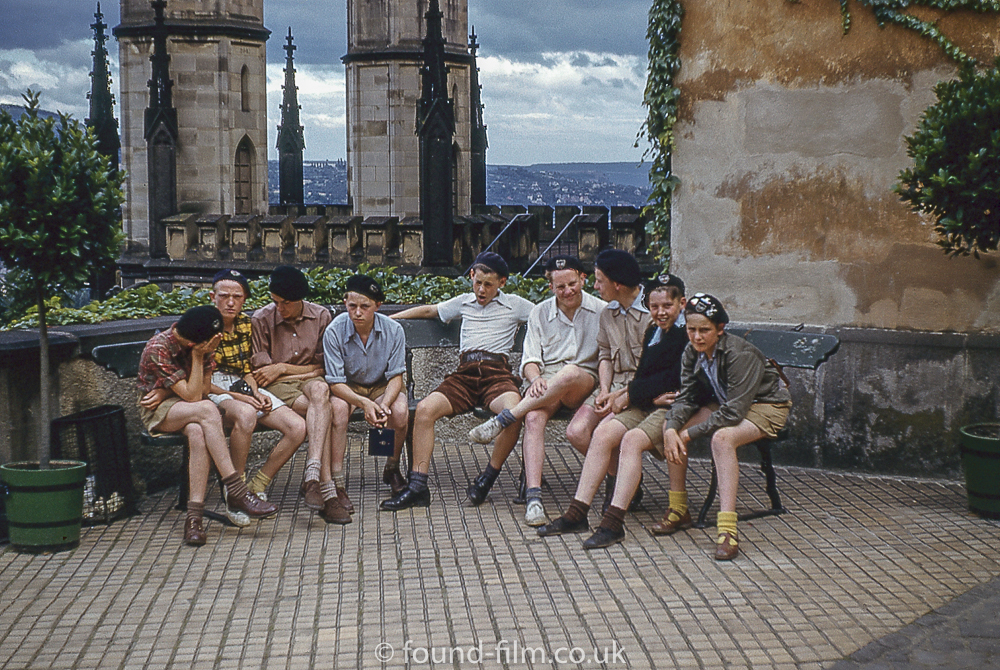 A group of boys on a curved seat