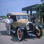 Man in America with a vintage car
