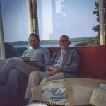 Two men reading magazines in Falmouth