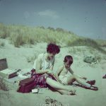 Boy and mother on beach