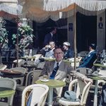 Relaxing in a cafe on a sunny day in the 1950s