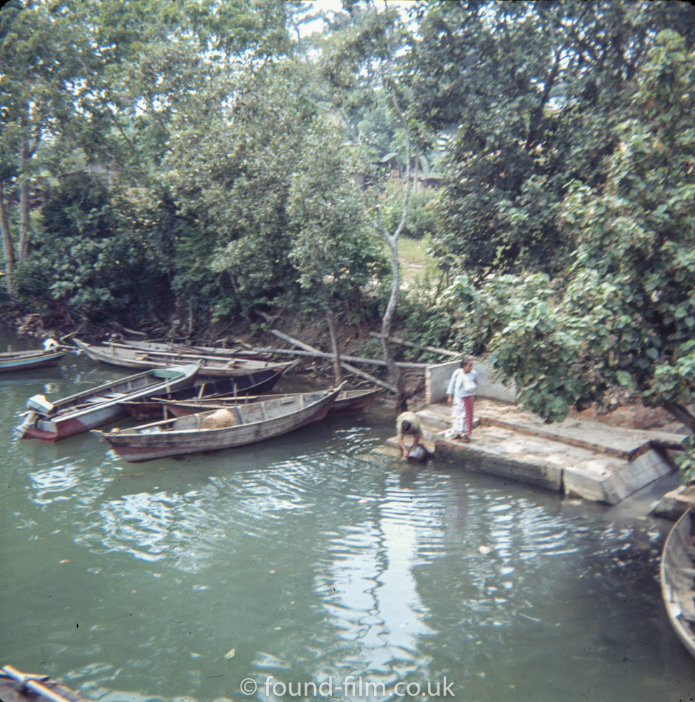 Gathering water from the river in Singapore