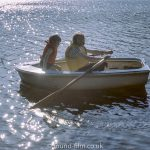 Two children in a row boat