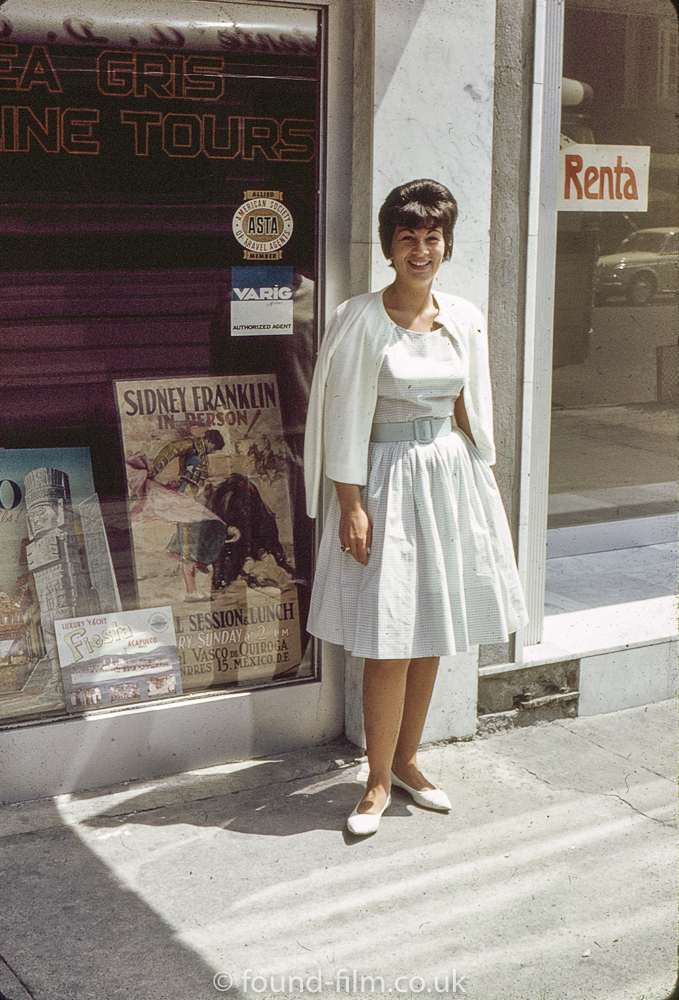 Young woman outside Travel Agency