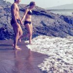 Couple standing in the sea at the seaside