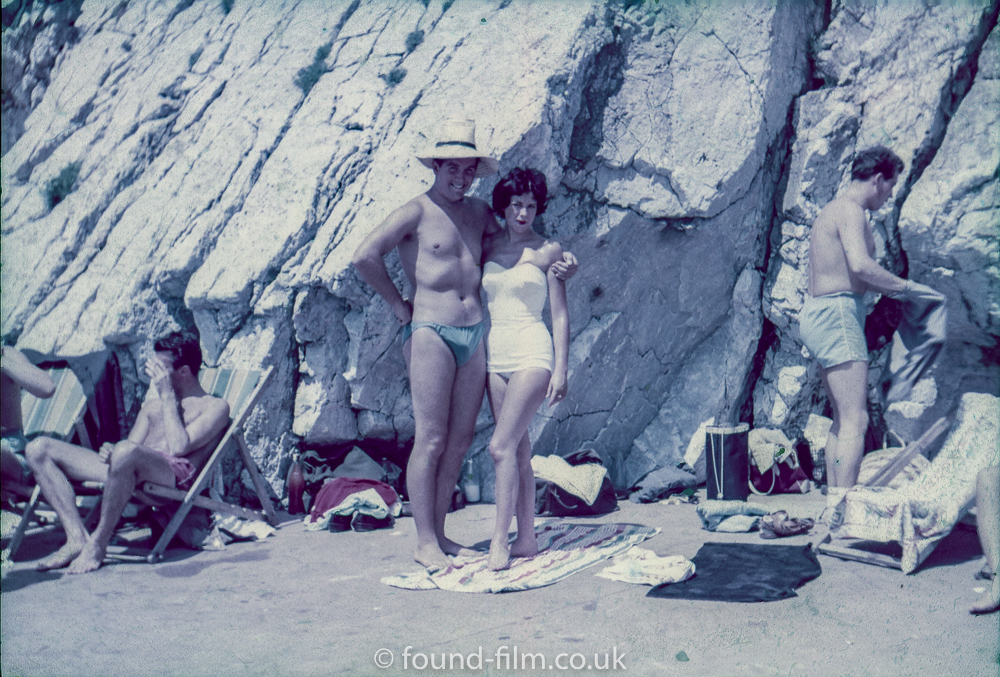 A couple pose at the seaside – possibly mid 1950s