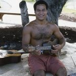 Musician playing a 4 string instrument, May 1984
