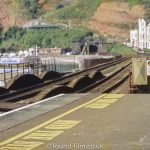 Dawlish railway station with track disappearing into tunnel.