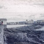 Unknown seaside town with seawall and theatre