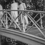 Two young ladies on a bridge