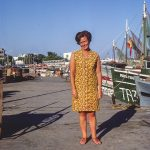 Holiday Snapshot of a woman standing on a dock in August 1969