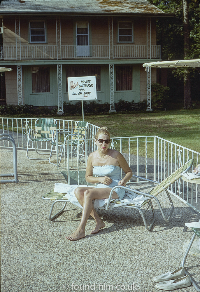 woman by swimming pool