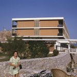 Woman posing by holiday home or hotel in September 1966