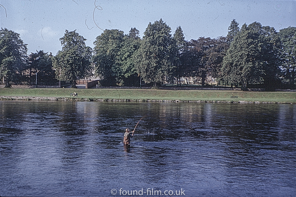 Salmon Fisher in a river in Scotland – probably Inverness.