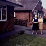 Two women in front garden
