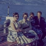 A Group on a boat trip on a Swiss lake c1960