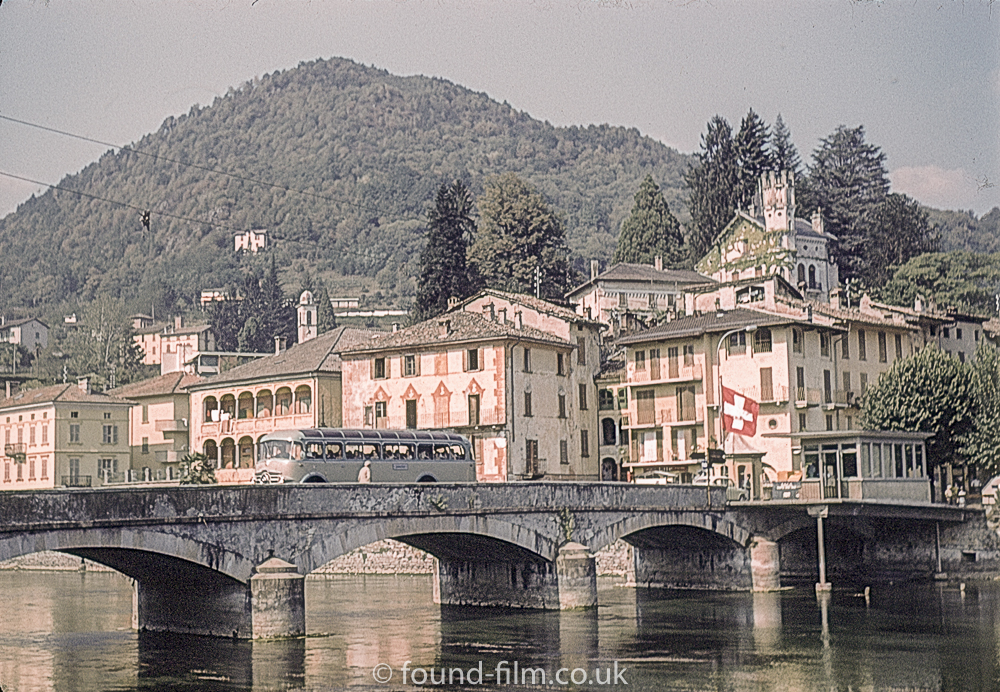 Bus crossing bridge to italy in Ponta Tresa in Switzerland in about 1961