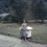 Woman in a Singapore garden in the mid 1960s