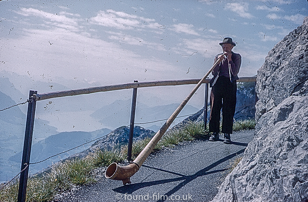 Alpine horn blower on Pilatus range in Switzerland 1962