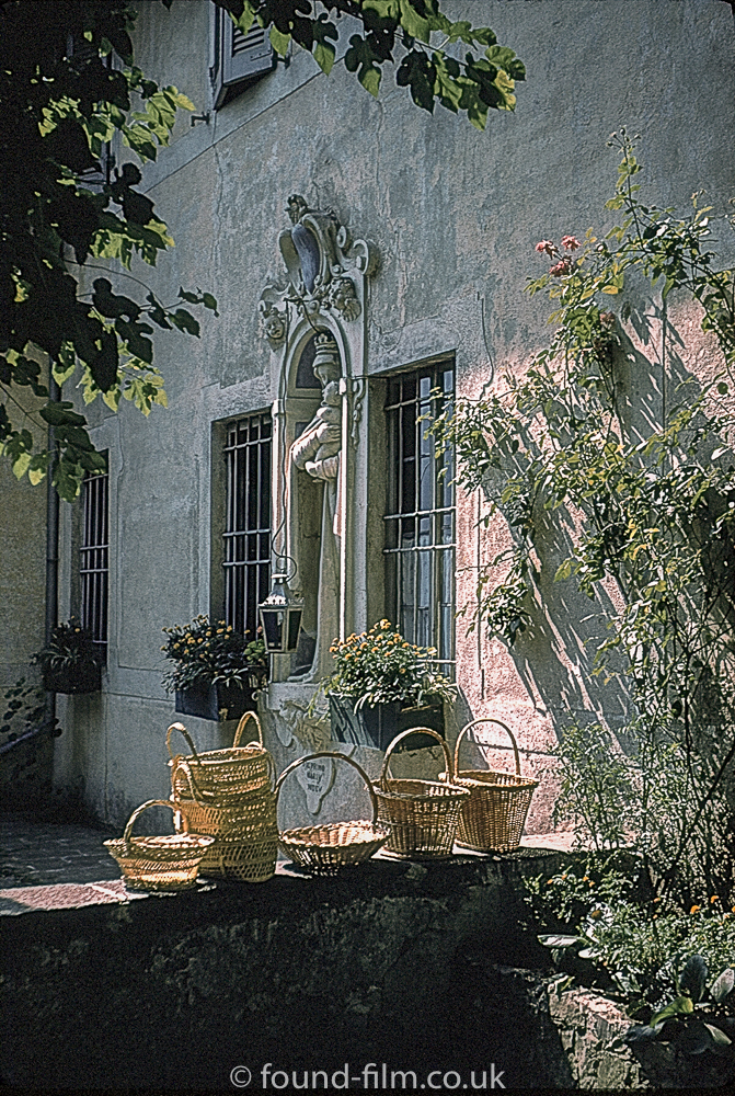 Baskets on a wall in Switzerland c1962