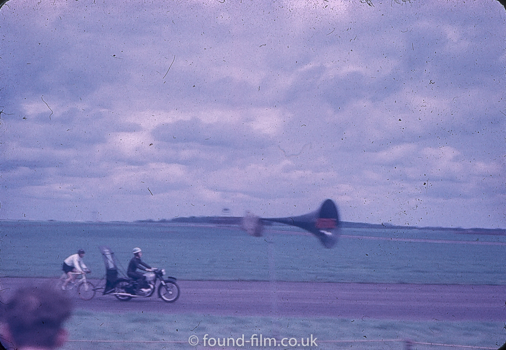 A cyclist at the 1950s motor racing event