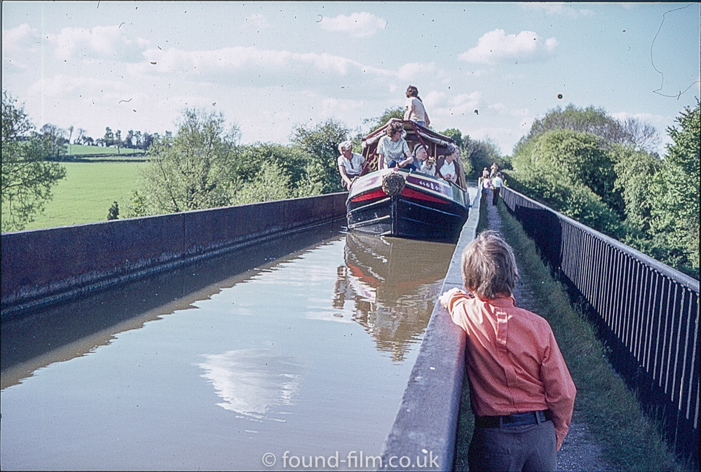 A Canal narrow boat on a Viaduct