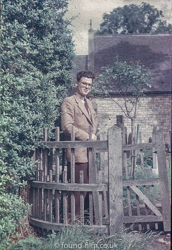 A young man posing by a church gate