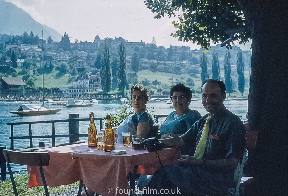 Group enjoying a Beer by the lake