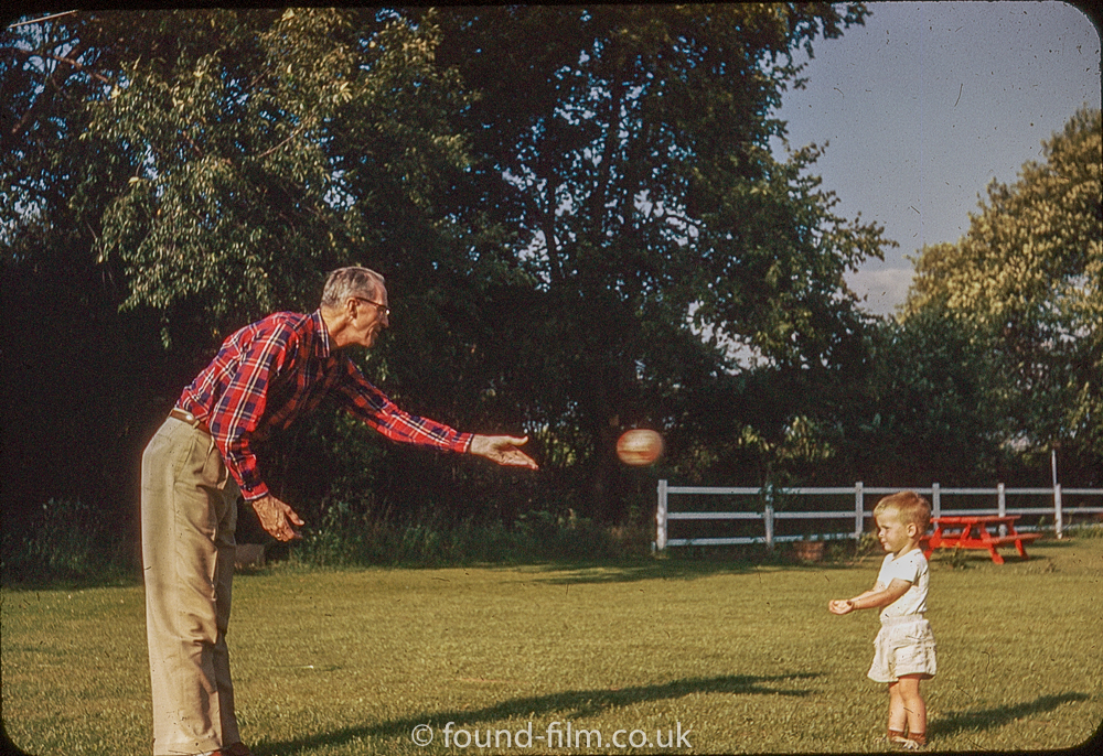 kodachrome red border colour slides - Man throwing a ball to a little girl